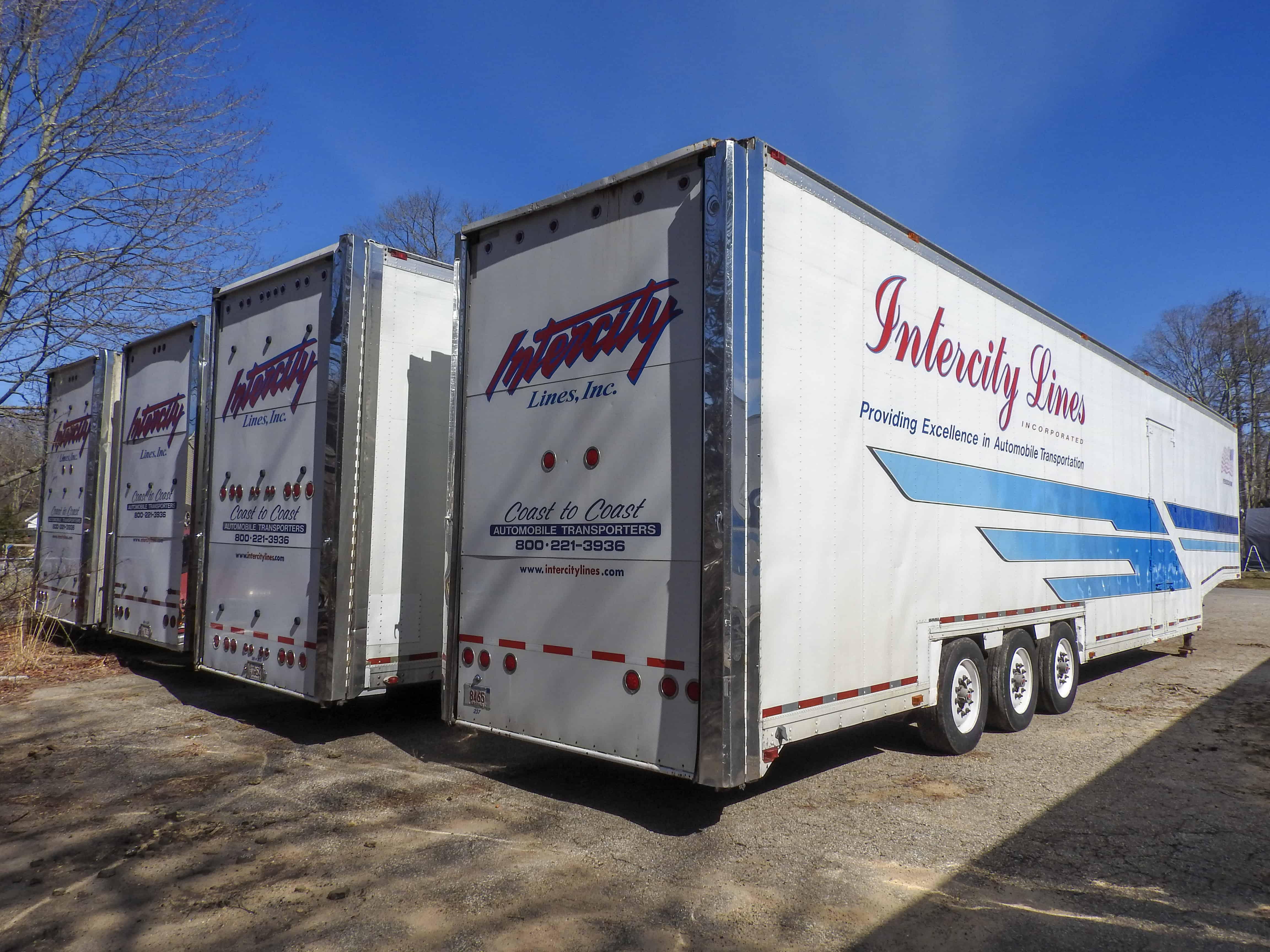 4 Intercity Lines Enclosed Auto Transport Trucks